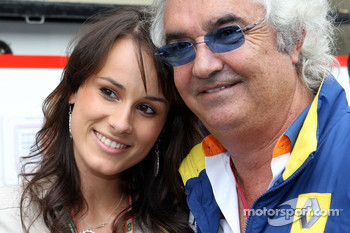 A Formula Una girl and team principal Flavio Briatore