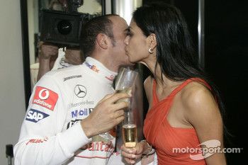 2008 World Champion Lewis Hamilton celebrates with girlfirend Nicole Scherzinger