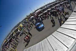The Miller Lite Dodge Crew push their car through inspection
