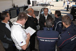 BMW Rahal Letterman Racing Team tests: Bobby Rahal and BMW Rahal Letterman Racing team members confer