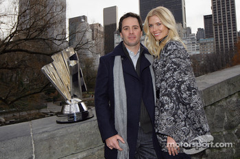 Jimmie and Chandra Johnson pose with the NASCAR Sprint Cup Series trophy on a bridge over The Pond in Central Park