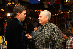 Jimmie Johnson shares a moment with car owner Rick Hendrick at Foley's