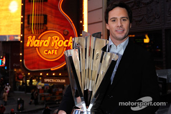 2008 NASCAR Sprint Cup Series Champion winner Jimmie Johnson holds the champion trophy atop Times Square Marquee at the Hard Rock Cafe