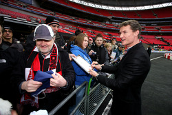 David Coulthard signs autographs for his fans
