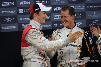 Podium: Michael Schumacher and Mattias Ekström