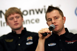 Jason Leffler, driver of the Great Clips Toyota, speaks as Steve Wallace, driver of the Five-Hour Energy Chevrolet looks on