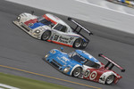 #58 Brumos Racing Porsche Riley: David Donohue, Antonio Garcia, Darren Law, Buddy Rice passes #01 Chip Ganassi Racing with Felix Sabates Lexus Riley: Juan Pablo Montoya, Scott Pruett, Memo Rojas for the lead