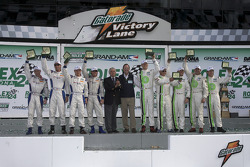 Victory lane: class and overall winners David Donohue, Antonio Garcia, Darren Law and Buddy Rice celebrate with Brian Redman, GT class winners Jorg Bergmeister, Andy Lally, Patrick Long, Justin Marks and RJ Valentine celebrate with Brian Redman