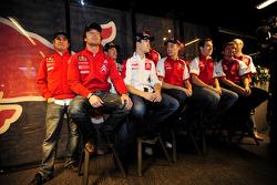 Rally winners Sébastien Loeb and Daniel Elena celebrate with Citroen Total World Rally team members