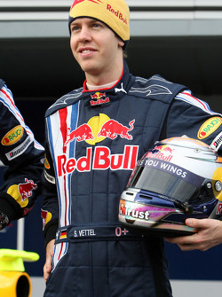 Sebastian Vettel poses with the new Red Bull RB5
