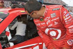 Juan Pablo Montoya, Earnhardt Ganassi Racing Chevrolet, looks amused as his daughter Paulina plays inside his car