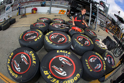 Penske Racing Dodge crew member prepares wheels