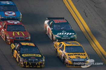 Matt Kenseth, Roush Fenway Racing Ford and Elliott Sadler, Richard Petty Motorsports Dodge battle for the lead in front of Reed Sorenson, Richard Petty Motorsports Dodge and Dale Earnhardt Jr., Hendrick Motorsports Chevrolet