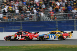 Kyle Busch, Joe Gibbs Racing Toyota, bump drafts former teammate Tony Stewart, Stewart-Haas Racing Chevrolet