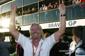Sir Richard Branson CEO of the Virgin Group celebrates the win