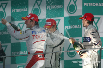 Podium: race winner Jenson Button, Brawn GP, second place Nick Heidfeld, BMW Sauber F1 Team, third place Timo Glock, Toyota F1 Team