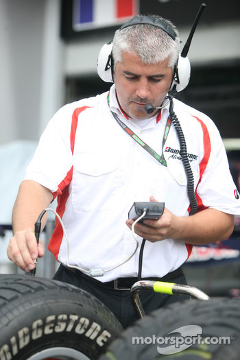 A Bridgestone tyre technician at work