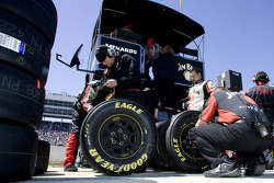 Robby Gordon's pit crew check tire wear after a pit stop