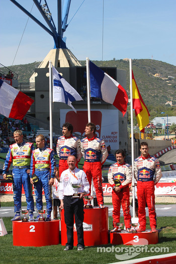 Podium: winners Sébastien Loeb and Daniel Elena, second place Mikko Hirvonen and Jarmo Lehtinen, third place Daniel Sordo and Marc Marti