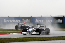 Nick Heidfeld, BMW Sauber F1 Team leads Nico Rosberg, Williams F1 Team