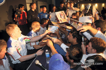 Jari-Matti Latvala hands out posters at the autograph signing session at Ford's Maipu Dealership in Cordoba