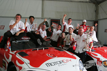 Race winner Vitantonio Liuzzi UP Team and Hasher Al Maktoum UP Team celebrates with the team