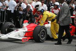 Race winner Helio Castroneves is taken to victory lane