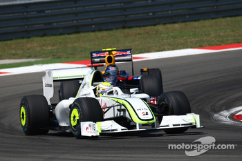 Jenson Button, Brawn GP leads Sebastian Vettel, Red Bull Racing