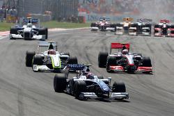 Kazuki Nakajima, Williams F1 Team leads Heikki Kovalainen, McLaren Mercedes and Rubens Barrichello, Brawn GP