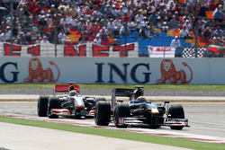 Sebastien Buemi, Scuderia Toro Rosso leads Lewis Hamilton, McLaren Mercedes