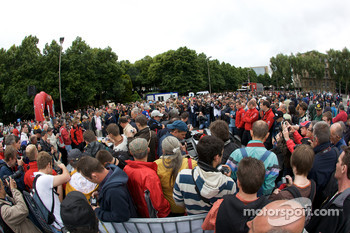 Fans watch as the Audi Sport North America Audi R15 TDI arrives at scrutineering