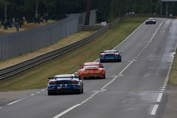#99 JMB Racing Ferrari F430 GT: Christophe Bouchut, Manuel Rodrigues, Yvan Lebon follows a group of cars
