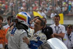 Race winner Marc Gene celebrates with Serge Saulnier