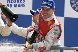 LMP1 podium: Tom Kristensen celebrates with champagne