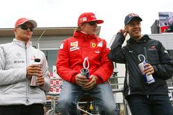 Heikki Kovalainen, McLaren Mercedes, Kimi Raikkonen, Scuderia Ferrari and Sebastian Vettel, Red Bull Racing