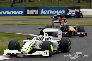 Rubens Barrichello, Brawn GP leads Mark Webber, Red Bull Racing