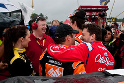 Tony Stewart, Stewart-Haas Racing Chevrolet, comes over to congratulate Joey Logano, Joe Gibbs Racing Toyota and his former crew chief Greg Zipadelli on their first win