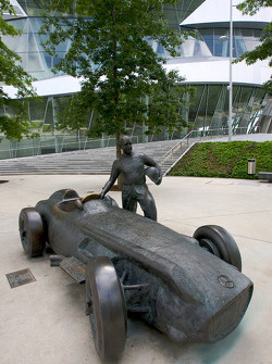A bronze statue of Juan Manuel Fangio and his Mercedes-Benz W196