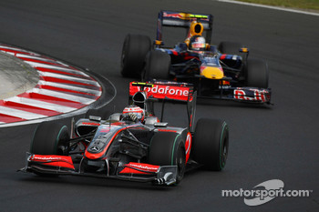Heikki Kovalainen, McLaren Mercedes and Sebastian Vettel, Red Bull Racing