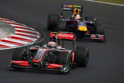 Heikki Kovalainen, McLaren Mercedes and Sebastian Vettel, Red Bull Racing