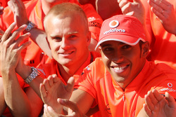 McLaren Mercedes victory celebration: race winner Lewis Hamilton celebrates with Heikki Kovalainen and McLaren Mercedes team members