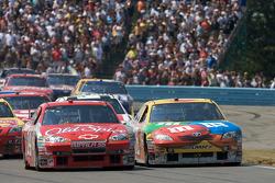 Restart: Tony Stewart, Stewart-Haas Racing Chevrolet and Kyle Busch, Joe Gibbs Racing Toyota battle for the lead