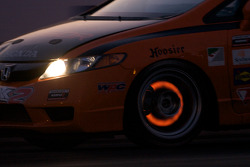 Glowing brakes on the #74 Compass360 Racing Honda Civic SI: Christian Miller, Benoit Theetge