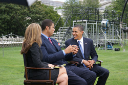 President Barack Obama listens to a question from ESPN analyst Brad Daugherty as host Nicole Manske looks on during NASCAR Now's live interview on the South Lawn of the White House in Washington, D.C.