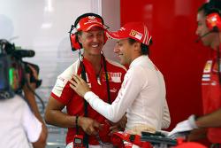 Michael Schumacher, Test Driver, Scuderia Ferrari in the garage with Luca Badoer, Test Driver, Scuderia Ferrari