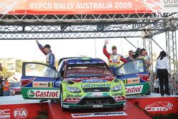 Podium: provisional second and final winners Mikko Hirvonen and Jarmo Lehtinen