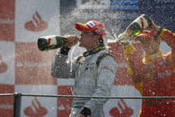 Luiz Razia celebrates his victory on the podium with Lucas Di Grassi