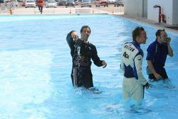 Daniel Ricciardo retrieves his kit