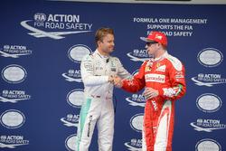 Polesitter Nico Rosberg, Mercedes AMG F1 Team and Kimi Raikkonen, Ferrari