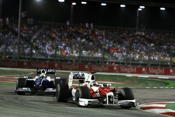 Jarno Trulli, Toyota Racing leads Nico Rosberg, WilliamsF1 Team